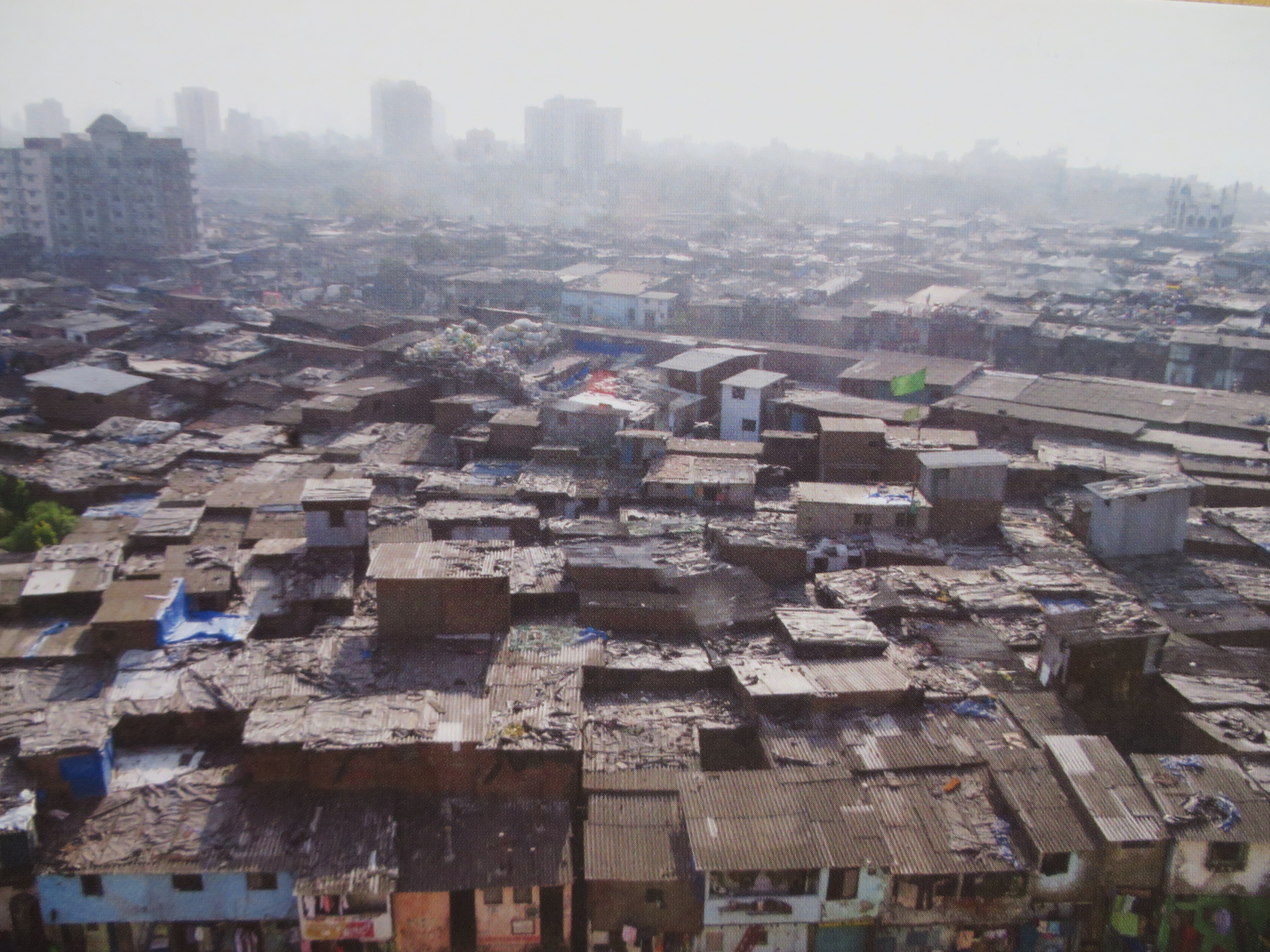 a definition of slum In slums in the absence of data on number of slum dwellers, un-habitat  produces estimates based on a definition of slums as agreed by the expert group .